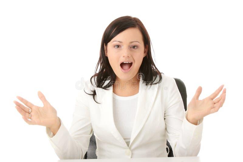 特写镜头服务台纵向坐的妇女 免版税库存照片