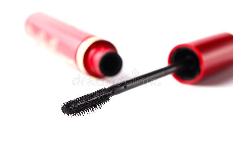 特写镜头染睫毛油瓶和刷子 黑染睫毛油鞭子和管是 免版税库存照片