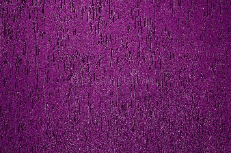特写镜头淡色紫色混凝土墙纹理背景 库存图片