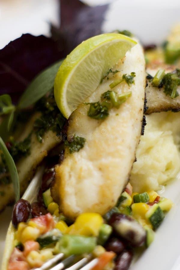 特写镜头烹饪烹调的鱼 免版税图库摄影