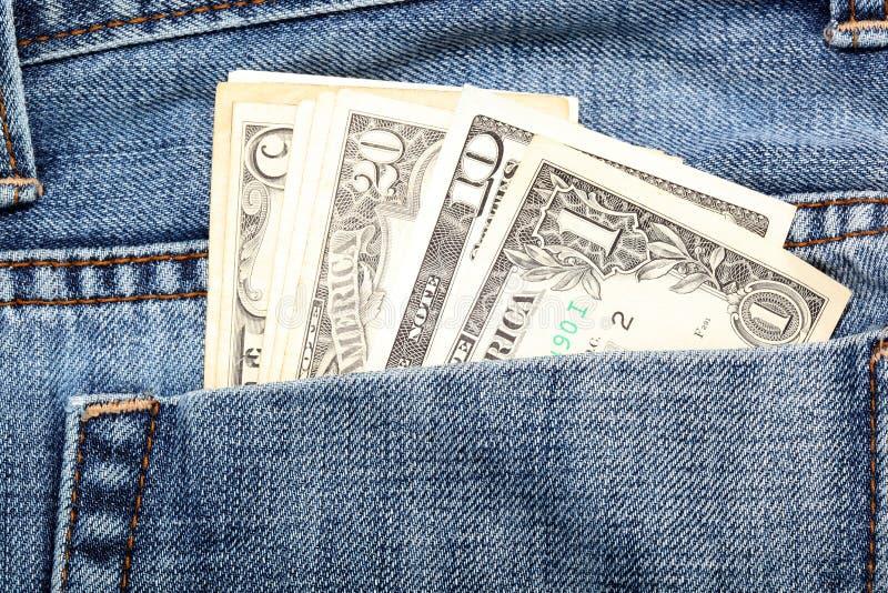 特写镜头牛仔裤货币 库存照片