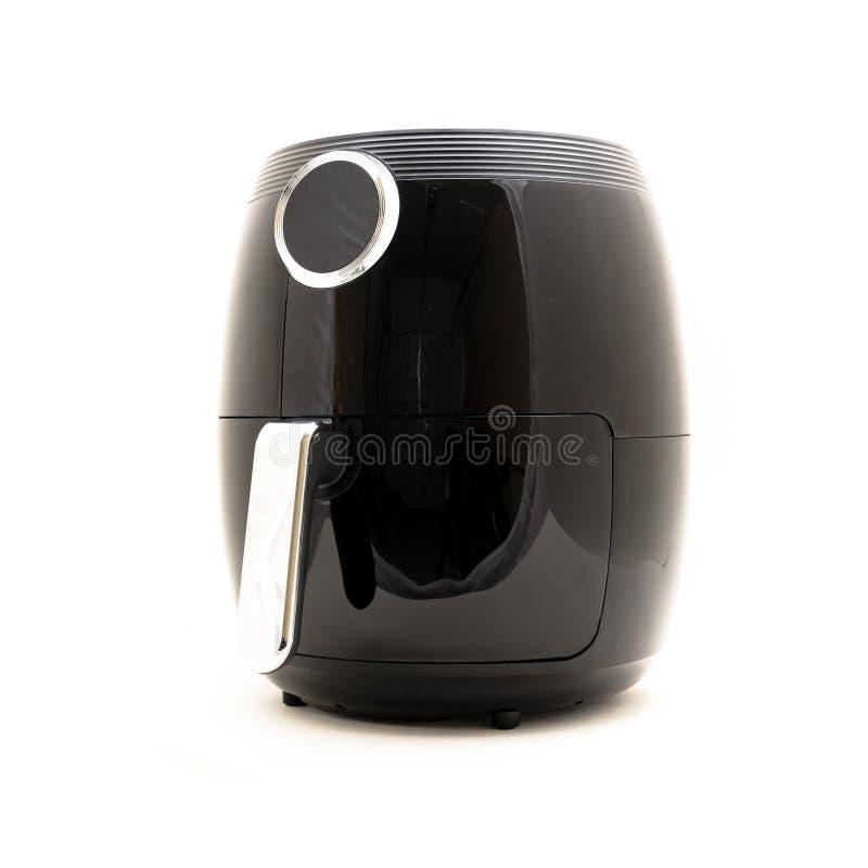 特写镜头空气炸锅在白色隔绝的厨房器具 库存照片