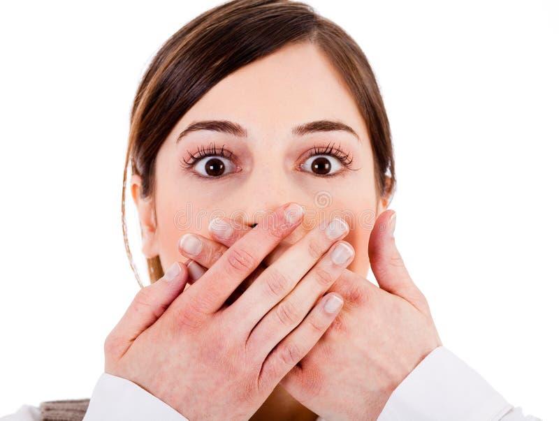 特写镜头覆盖物新她的嘴的妇女 免版税库存照片