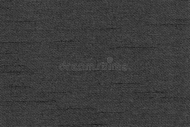 特写镜头黑颜色织品纹理 带状线黑色织品样式设计或室内装饰品抽象背景 库存图片