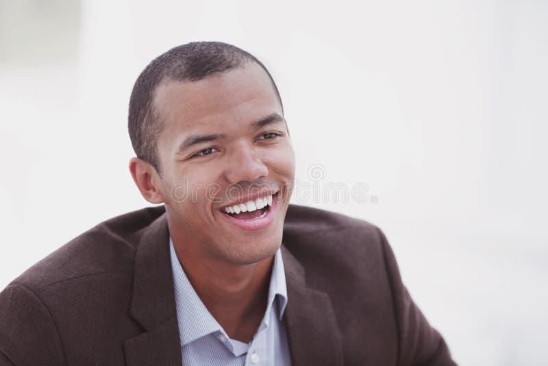 特写镜头 一个英俊的商人的画象白色背景的 库存照片