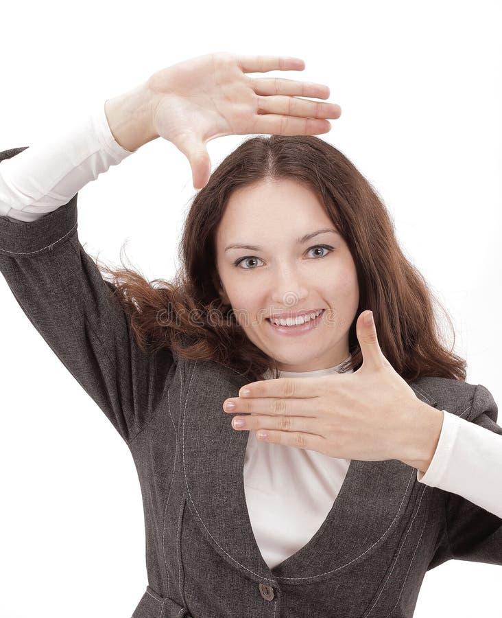 特写镜头 做画框的快乐的女商人由他的手 免版税库存照片