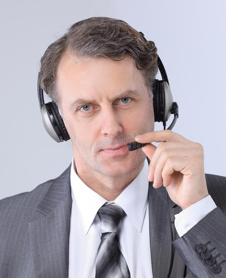 特写镜头 确信的雇员电话中心画象  库存照片