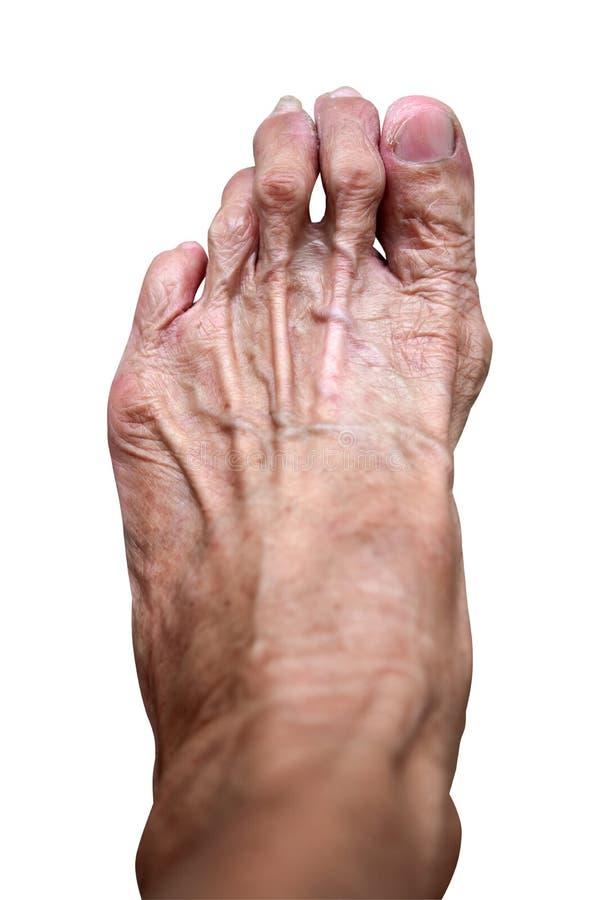 特写镜头典雅的年长妇女皮肤和脚,隔绝在白色背景 免版税库存照片