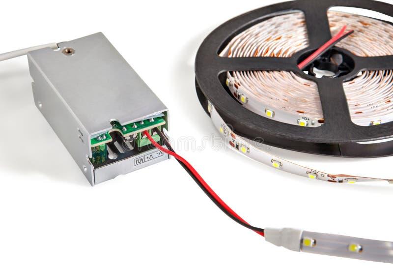 特写镜头在塑料卷轴的被带领的磁带连接到当前交换器 库存图片