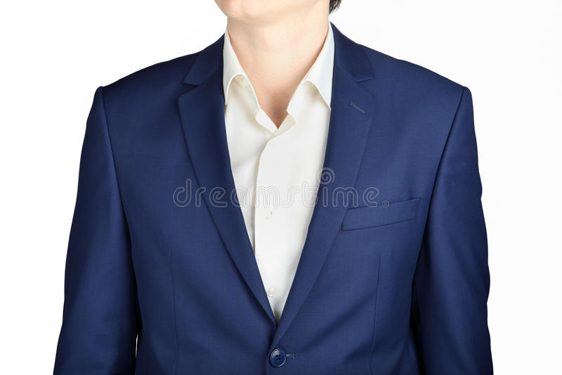 特写镜头藏青色人的衣服外套,被隔绝在白色 库存照片