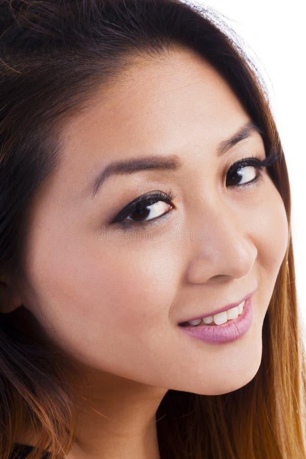 特写镜头画象有吸引力亚裔美国人妇女微笑 图库摄影