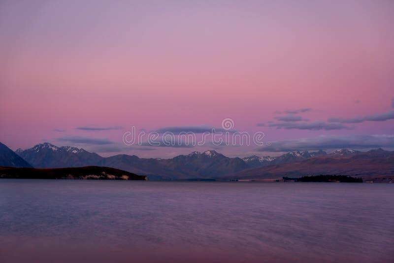 特卡波湖,新西兰五颜六色的梦想的风景日落的 图库摄影