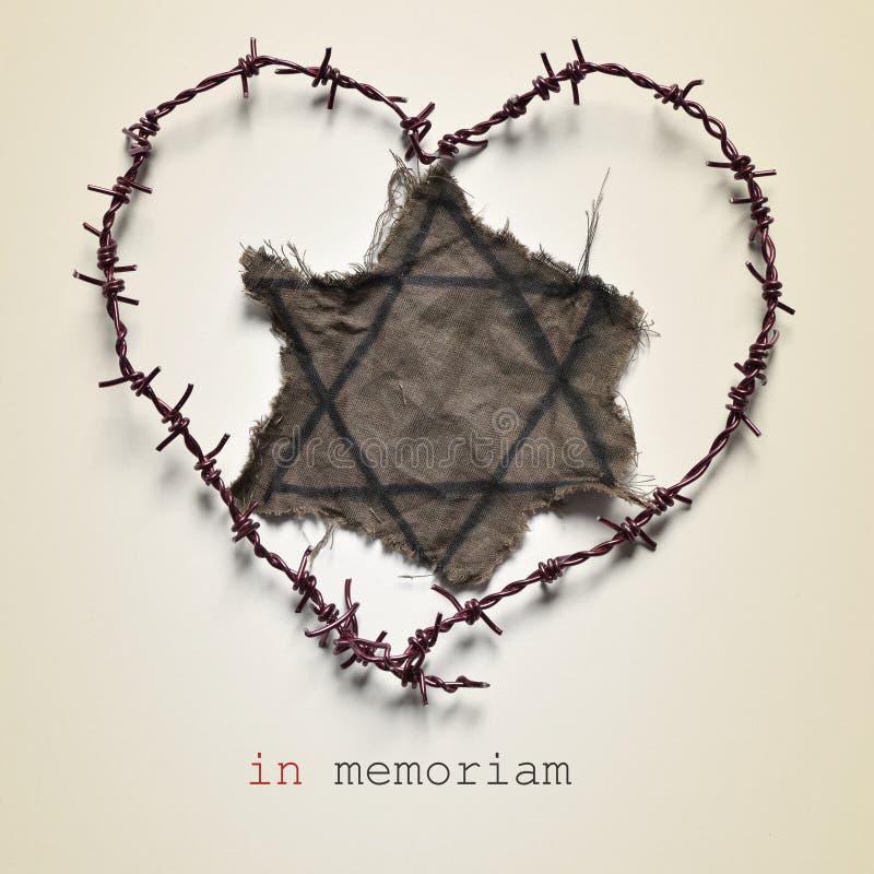 犹太徽章和文本在memoriam 图库摄影