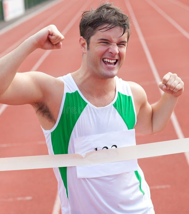 狂喜的表达式显示短跑选手胜利 库存图片