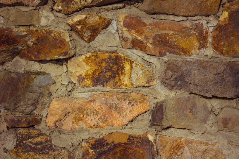 狂放的石头墙壁  库存图片