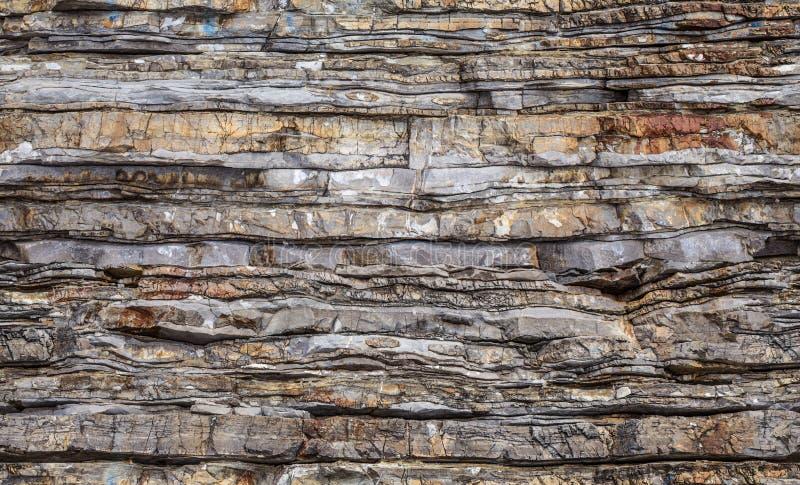 狂放的破裂的石头无缝的样式背景  免版税库存图片