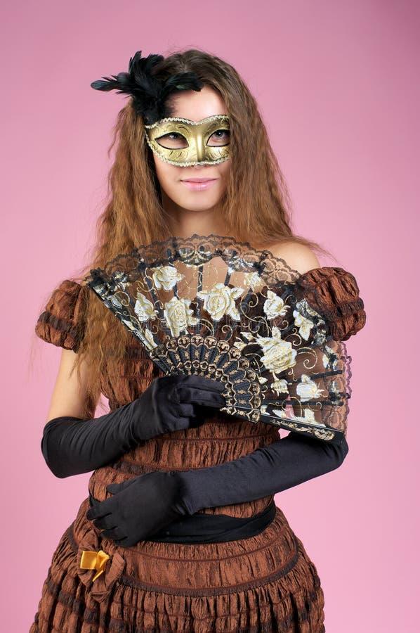 狂欢节逗人喜爱的屏蔽妇女年轻人 库存图片