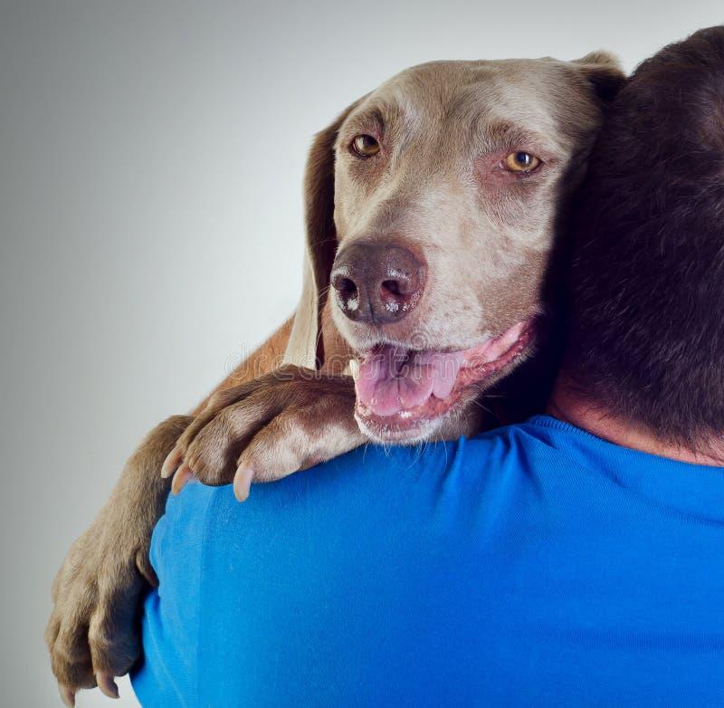 狗和人 免版税图库摄影