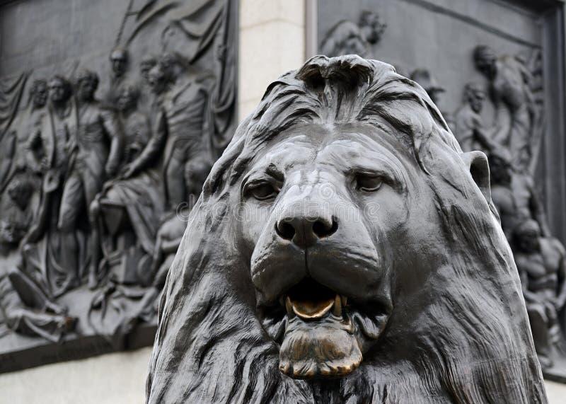 狮子的雕象,特拉法加广场,伦敦 免版税图库摄影