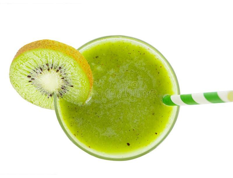 猕猴桃酸奶圆滑的人汁液和猕猴桃绿色果子早餐在白色背景的早晨从顶视图 免版税库存照片