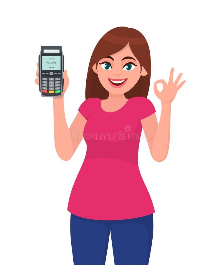 猛击机器的俏丽的愉快的年轻女人陈列/藏品pos付款终端或信用/借记卡,打手势okay/OK标志 库存例证