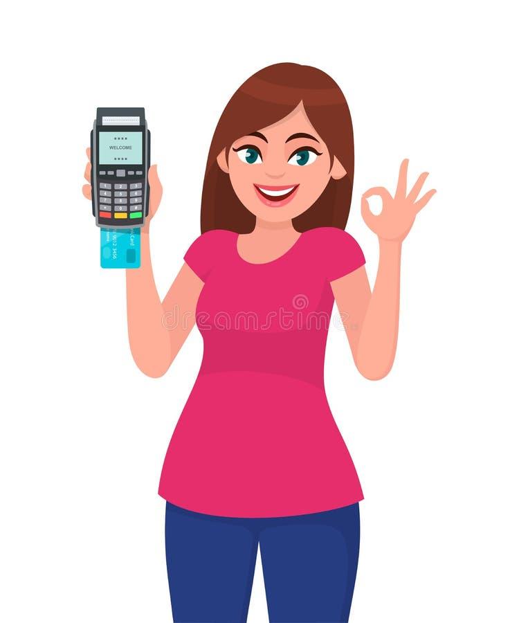 猛击机器的愉快的年轻女人陈列/藏品pos付款终端或信用/借记卡,打手势okay/OK标志 库存例证