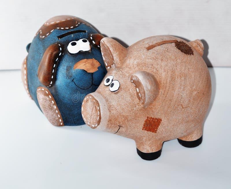 猪和狗贪心银行 免版税库存图片
