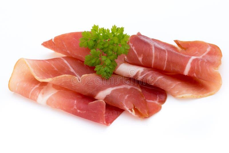猪肉在白色背景隔绝的火腿切片 免版税图库摄影
