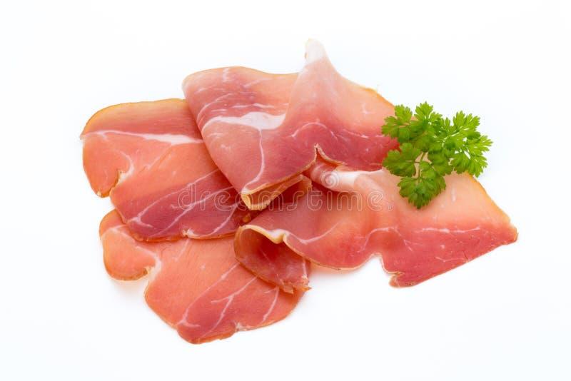 猪肉在白色背景隔绝的火腿切片 库存照片