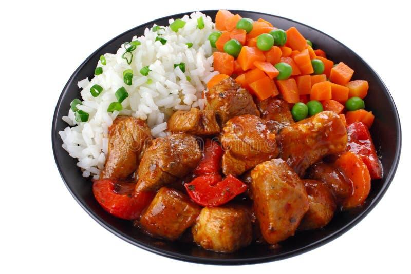 猪肉炖煮的食物用米 免版税库存图片