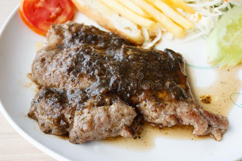猪肉牛排用黑胡椒 图库摄影