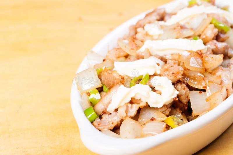 猪肉sisig一个普遍的纤巧在菲律宾 免版税库存照片