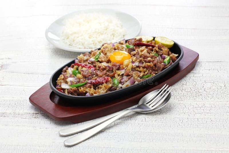猪肉sisig,菲律宾烹调 库存图片