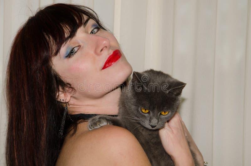 猫和妇女 免版税库存照片