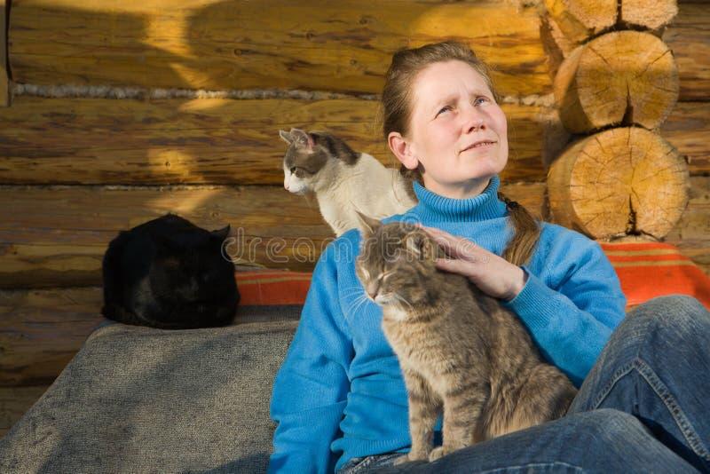 猫她的妇女 免版税图库摄影