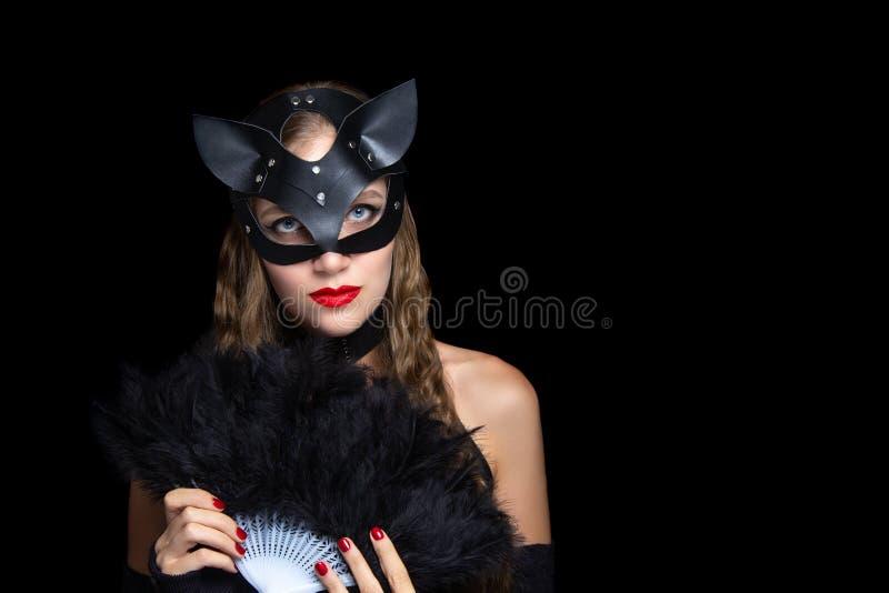 猫妇女bdsm角色戏剧 免版税库存图片