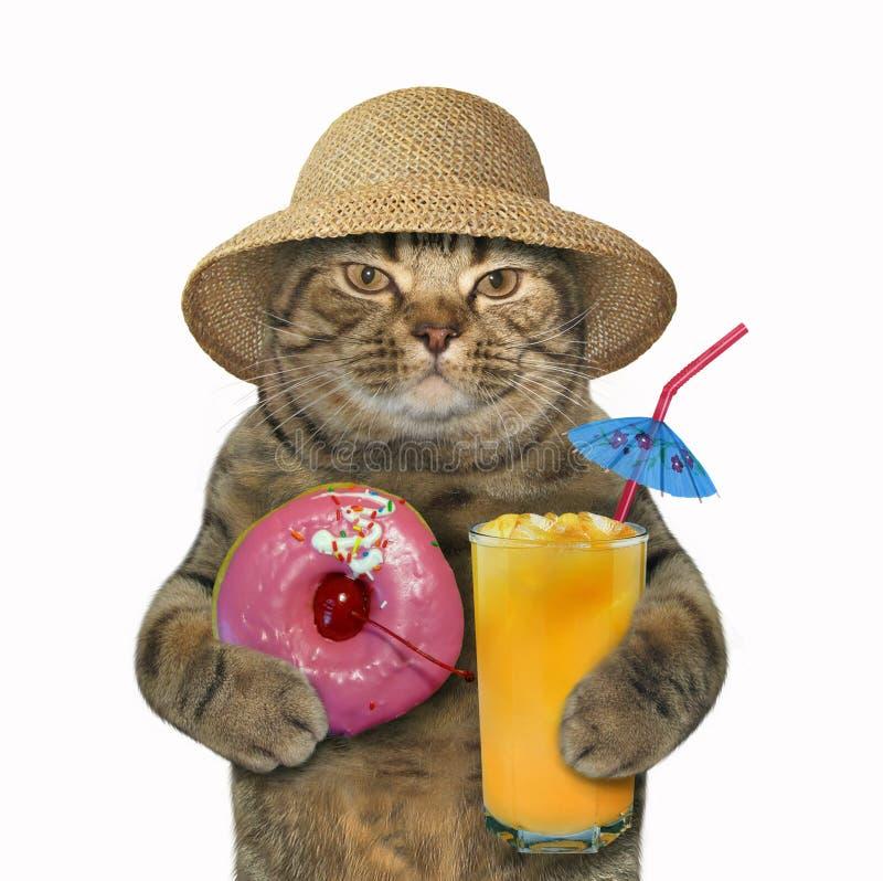 猫用桃红色多福饼和汁液 库存图片