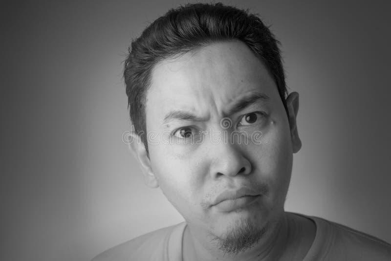 玩事不恭的亚洲人表示 免版税库存照片