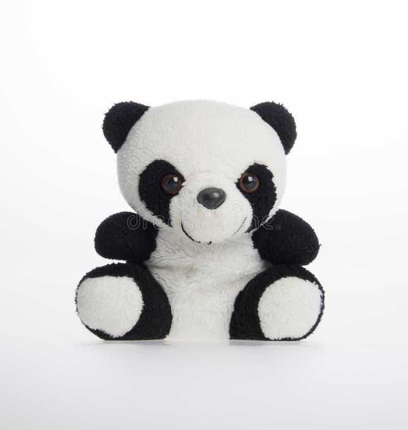 玩具或熊猫软的玩具在背景 库存图片