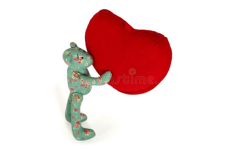 玩具熊举行在爪子红色心脏 免版税图库摄影