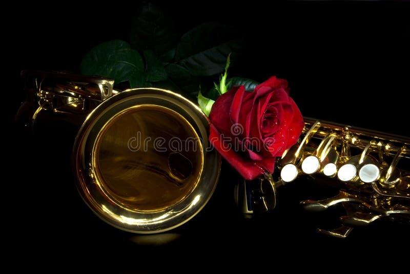 玫瑰色萨克斯管 免版税库存照片