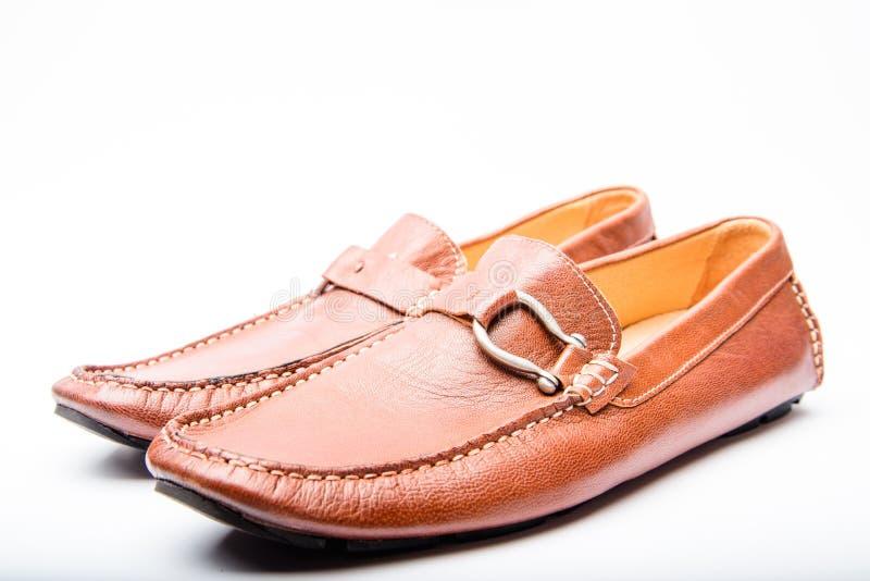 现代和减速火箭的鞋子概念 r 人的鞋类 对时兴的鞋子 男性褐色 图库摄影