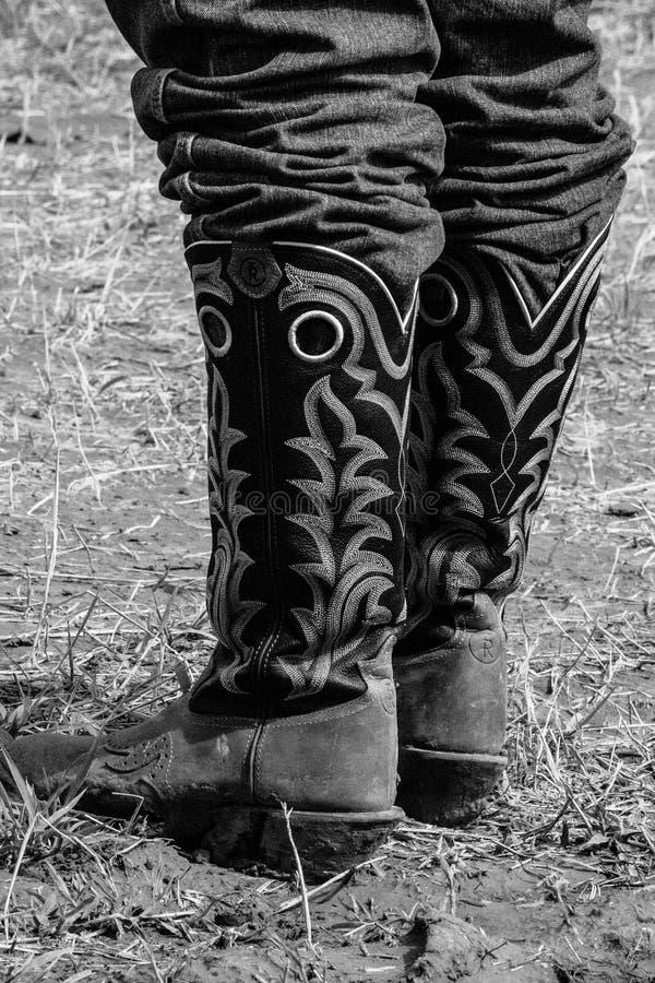 现代天运转的牛仔靴 库存图片