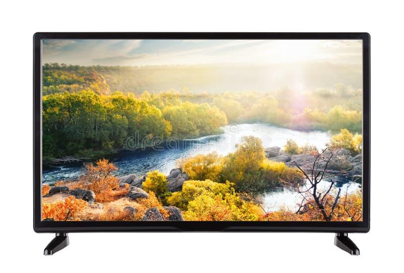 现代平面式屏幕电视和秋天环境美化与对此的河 库存照片