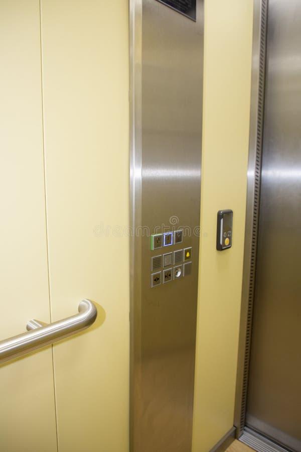 现代按钮电梯内部和外部合金黄色银 免版税库存图片