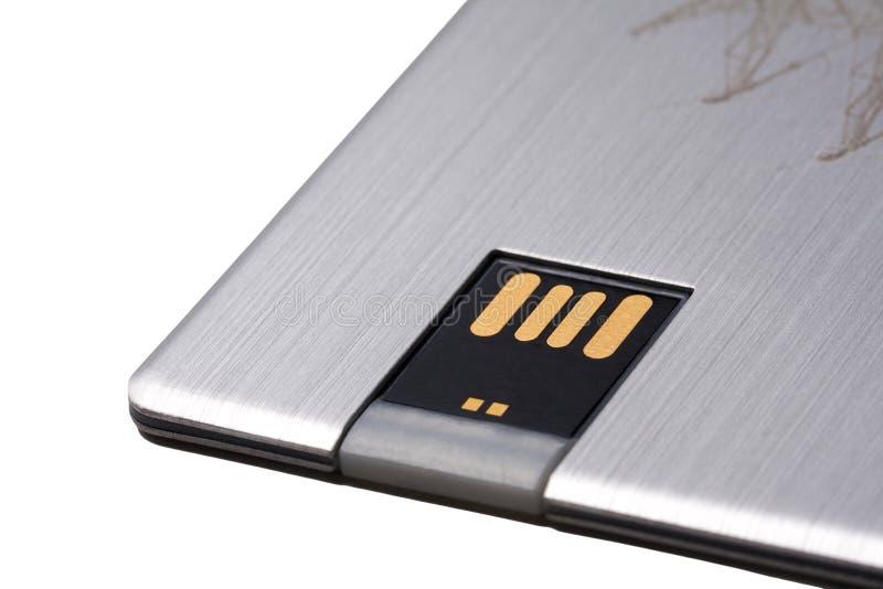 现代USB数据记忆棍子,新的便携式的与在白色背景隔绝的金黄连接器的口袋卡片一刹那驱动 库存照片