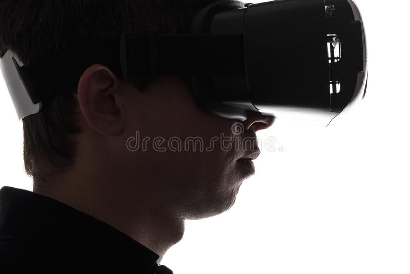 现出轮廓一个人的画象虚拟现实玻璃的 库存图片