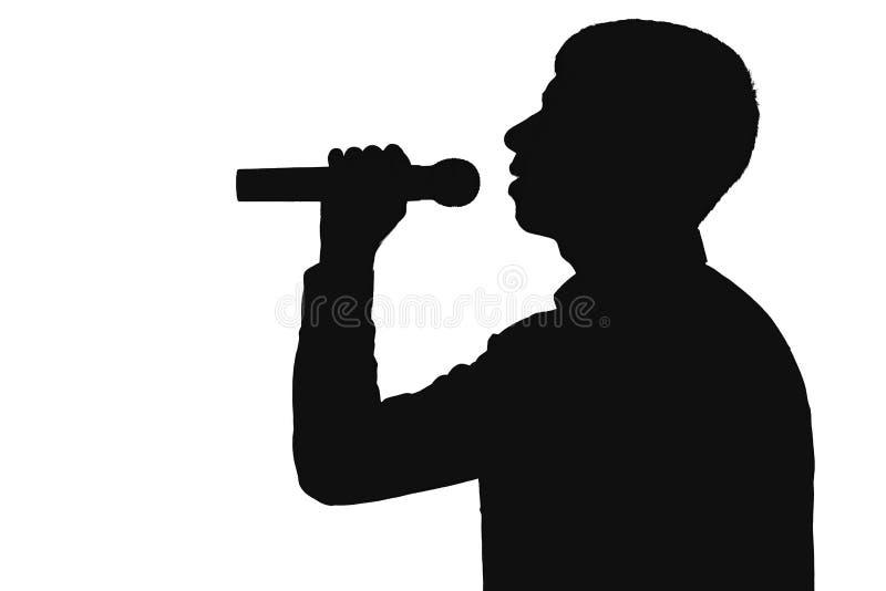 现出轮廓唱歌入话筒的一个人的档案 免版税图库摄影