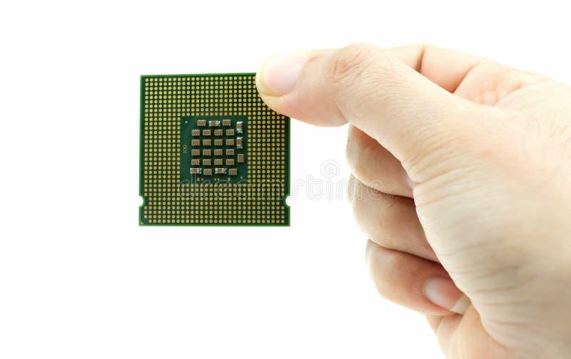 现实cpu后面视图处理机碎片在手中 库存照片