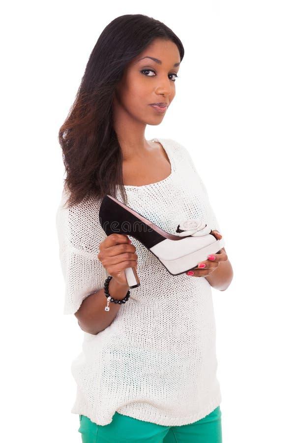 现有量停顿她的高藏品鞋子妇女 免版税库存图片